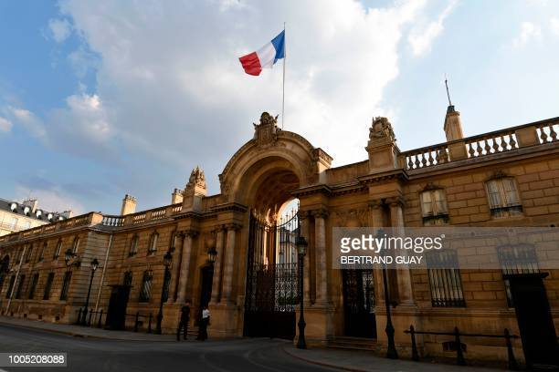 Policemen stand guard outside the Elysee Palace during a search at the office of former top presidential security aide Alexandre Benalla, charged...