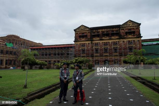 Policemen stand guard outside the historic Secretariat building in Yangon on July 19 on the 70th anniversary when Myanmar independence hero General...