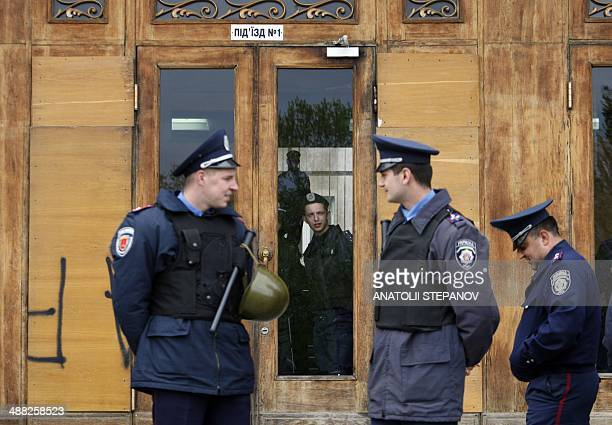 Policemen stand guard outside the regional state administration building in the southern Ukrainain port city of Odessa on May 5 expecting a protest...