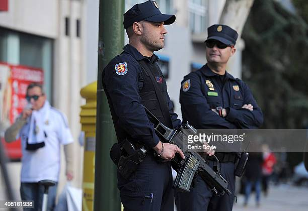 Policemen stand guard outside the Santiago Bernabeu stadium during tight security ahead of the La Liga match between Real Madrid and Barcelona at...