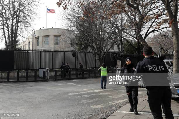 Policemen stand guard outside the United States embassy in Ankara on March 5 as part of security measures set after the embassy was closed to the...