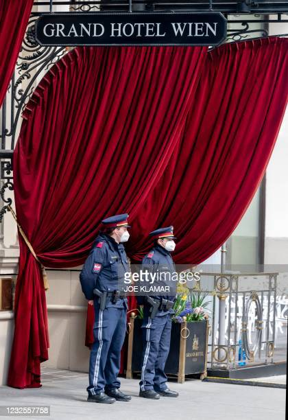 Policemen stand guard outside to the 'Grand Hotel Wien' for the closed-door nuclear talks with Iran in Vienna on April 27 where diplomats of the...