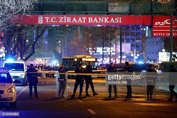 Policemen stand guard the streets after a blast in Ankara on March 13 2016 An explosion ripped through a busy square in central Ankara on March 13...
