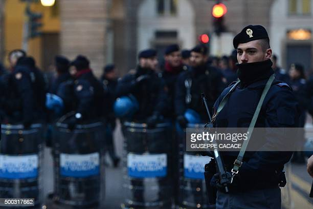 Policemen stand in front of La Scala opera house before the Premiere of Giovanna d'Arco of Giuseppe Verdi for the season opener 2015/2016 on December...