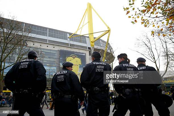 Policemen stand in front of the stadium prior to the Bundesliga match between Borussia Dortmund and FC Schalke 04 at Signal Iduna Park on November 8...
