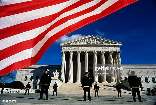 Policemen stand in front of the Supreme Court Building during the March for Life on January 22, 2003. Anti-abortion activists and pro-abortion...