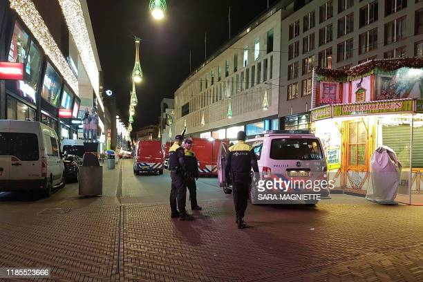 Policemen stand near a police cordon at the Grote Marktstraat one of the main shopping streets in the centre of the Dutch city of The Hague after...