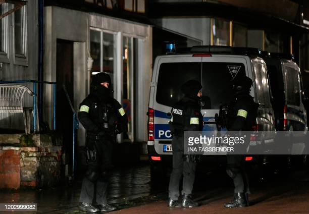 Policemen stand near the house of a driver who steered his car into a carnival procession February 24 2020 in Volkmarsen near Kassel central Germany...