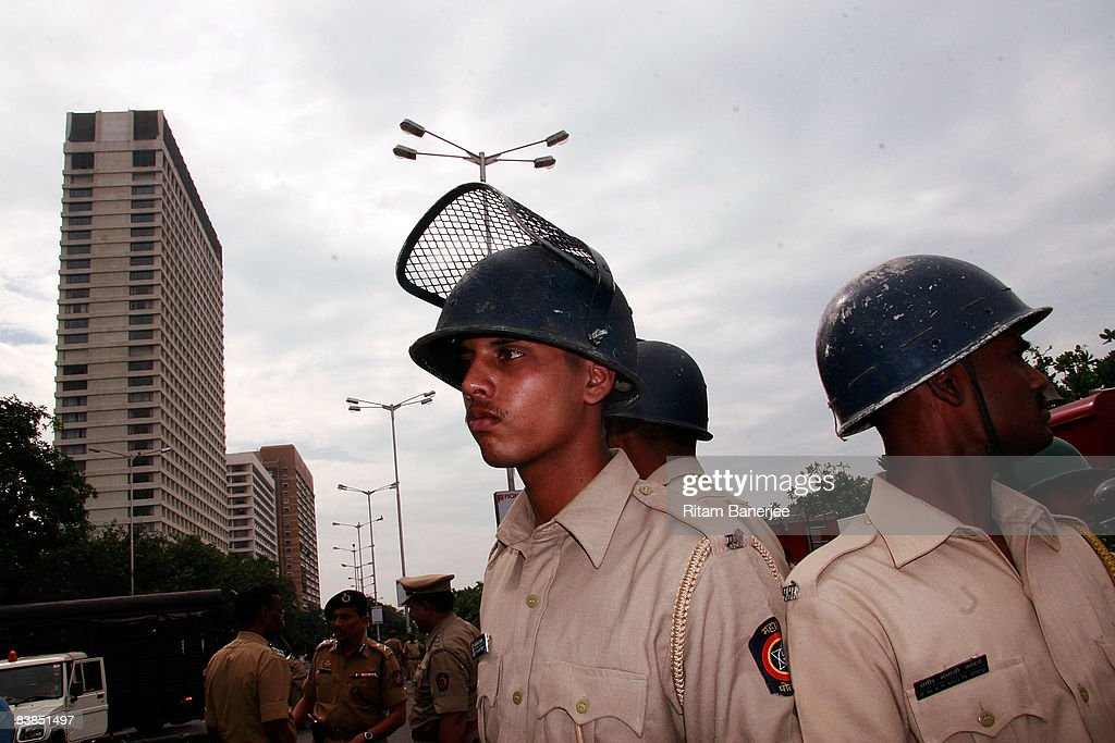 Policemen stand on high alert outside the Oberoi Hotel on November 28, 2008 in Mumbai, India. Following terrorist attacks on three locations in the city, troops are now working to free the remaining hostages being held inside the Taj Mahal Palace Hotel.
