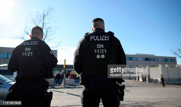 Policemen stand on March 18, 2019 in front of the Higher Regional Court in Dresden, eastern Germany, where a trial starts against a Syrian man...