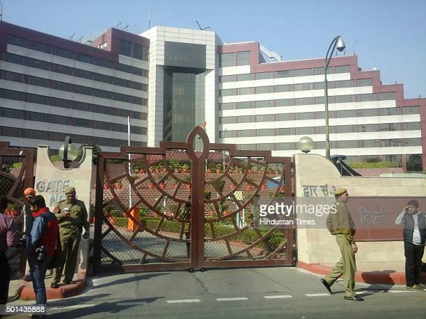 Policemen stand on the gates of the Delhi Secretariat during CBI raid at the office of Rajendra Kumar Gupta Principal Secretary to Delhi Chief...