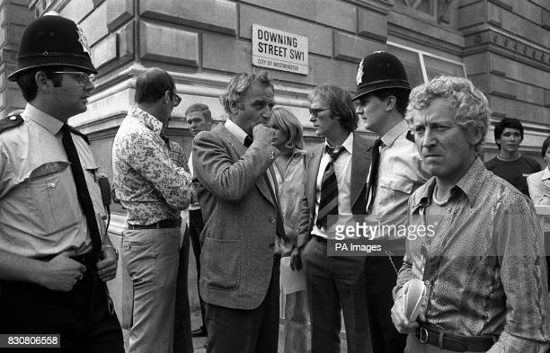 Policemen stand with the top cops from Van Der Valk' and 'The Sweeney' outside 10 Downing Street while they presented a petition protesting over...