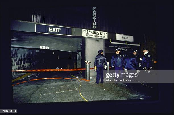 Policemen standing nr cordoned off World Trade Ctr underground parking garage entrance/exit ramps following fatal bomb explosion