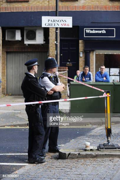 Policemen stands around the Parsons Green Underground Station Several injured at Parsons Green as passengers report seeing device on District Line...