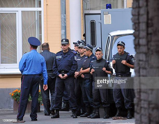 Policemen stands guard around a vehicle believed to convey Ukraine's former prime minister Yulia Tymoshenko as it arrives the Pechersk district court...
