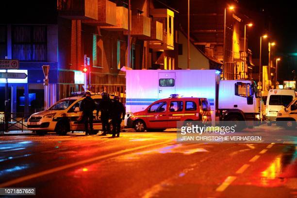Policemen stands in the Neudorf area of Strasbourg eastern France after a shooting breakout on December 11 2018 Two persons has been killed and 11...