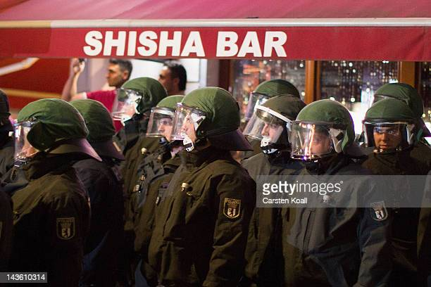 Policemen staying in front of the Shisha Bar during a Walpurgis Night demonstration on April 30, 2012 in Berlin, Germany. Police are bracing for...