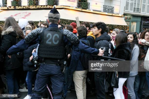 Policemen stop students boulevard SaintGermain on December 11 as they take part in a demonstration in Paris France to protest against the different...