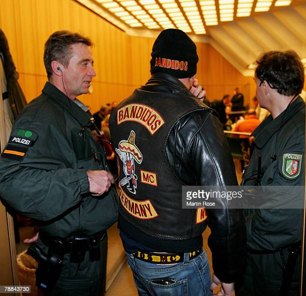 Policemen surround a member of the biker group 'Bandidos' outside the district court on January 92008 in Muenster Germany The two biker groups at...