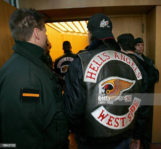 Policemen surround a member of the biker group 'Hells Angels' outside the district court on January 92008 in Muenster Germany The two biker groups at...