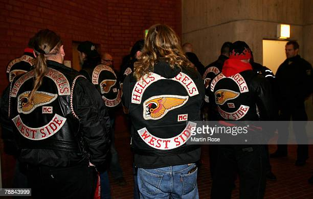 Policemen surround a member of the biker group 'Hells Angels' outside the district court on January 9 2008 in Muenster Germany The two biker groups...