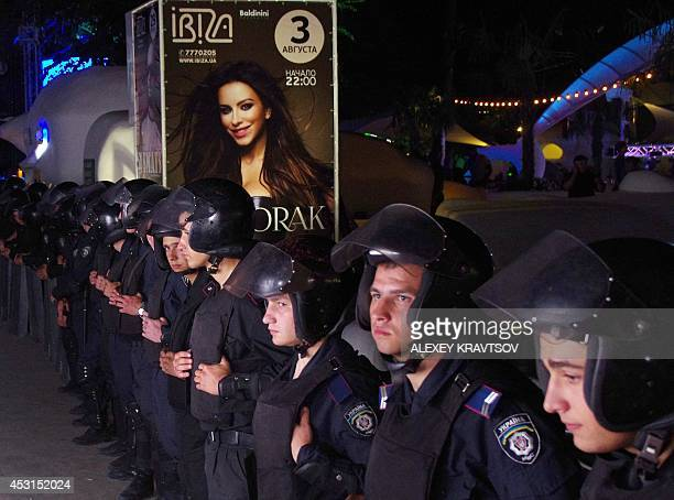 Policemen surround the hall as Maidan activists try to prevent a concert of pop singer Ani Lorak in the southern Ukrainian city of Odessa late on...