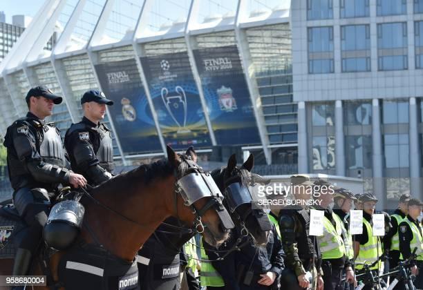 Policemen take part in the exercises at NSC Olimpiyskiy Stadium in Ukrainian capital of Kiev on May 15 2018 Kiev is preparing for the 2018 UEFA...