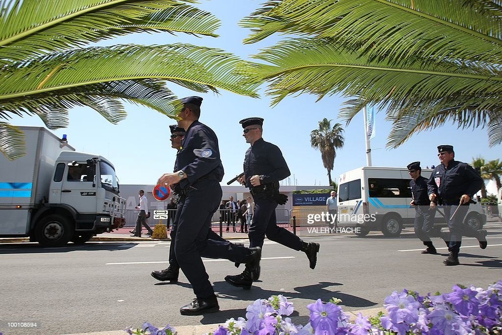 Policemen take position next to the Palais des Festivals during a protest against the film 'Outside Of The Law' by French-Algerian director Rachid Bouchareb, whom they accuse of distorting history, on the sidelines of the 63rd Cannes Film Festival on May 21, 2010 in Cannes. Opening with a massacre of Algerian civilians by French soldiers in the town of Setif in 1945 -- a controversial historical event which some critics say has been misrepresented -- the film is one of very few cinematic treatments of the conflict.