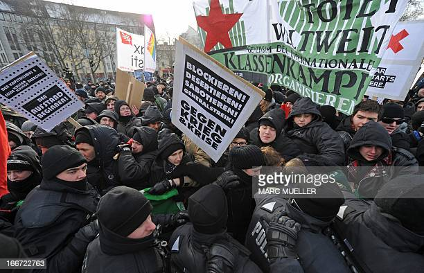 Policemen try to contain antiwar demonstrators trying to approach the Bayerischer Hof hotel in Munich southern Germany on February 4 2012 where the...