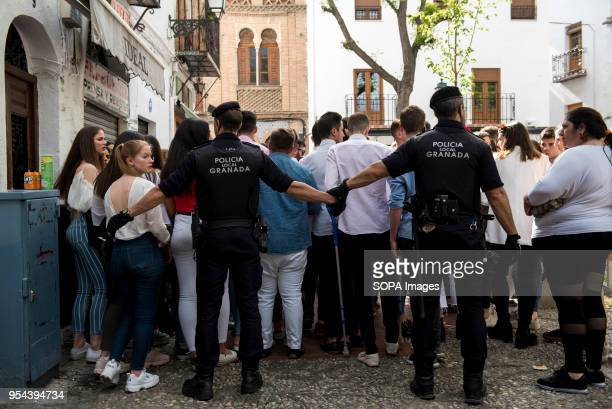Policemen try to empty Plaza Larga Square of people during the Dia de las Cruces festival'El día de la Cruz or Día de las Cruces is one of the most...