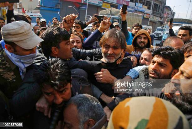 Policemen try to stop chairman of Jammu and Kashmir Liberation Front Muhammad Yasin Malik and his supporters as they try to march towards the...