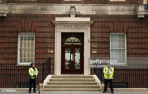 Policemen wait outside the Lindo Wing after it was announced that the Duchess of Cambridge has gone into Labour at St Mary's Hospital on May 2 2015...
