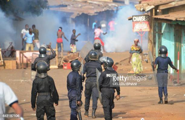 TOPSHOT Policemen walk in a street during a protest of teachers asking for wage increase and more hiring on February 20 2017 in Conakry BINANI