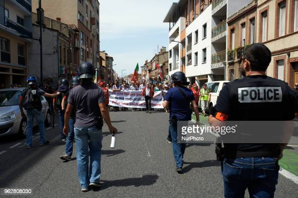 Policemen walk in front of the demonstration A quotmaree populairequot demonstration was called by more than 60 political organisations associations...