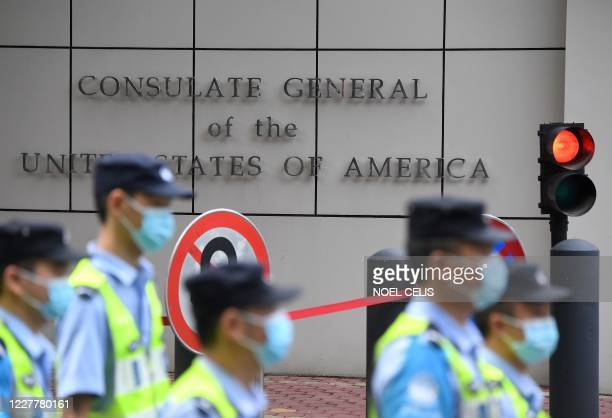 Policemen walk past the US consulate in Chengdu, southwestern China's Sichuan province, on July 26, 2020. - Tensions have soared between the two...