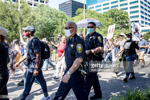 Policemen walk with protesters during the City Collective Prayer March on June 7 in Norfolk VA The event Prayer March A Peaceful Demonstration for...