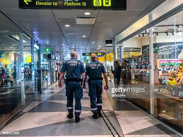 Policemen walking through Stockholm central station, Sweden