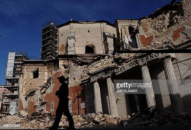 Policemen walks by the Palazo de Governo in downtown L'Aquila prior to the visit by Italian Prime Minister Silvio Berlusconi and US President Barack...