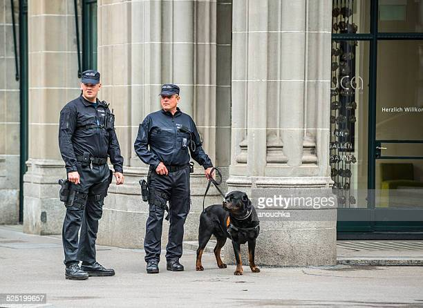 policemen with dog on zurich street, switzerland - police dog stock photos and pictures