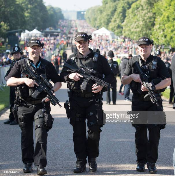Policemen with guns patrol at the wedding of Prince Harry to Ms Meghan Markle at St George's Chapel Windsor Castle on May 19 2018 in Windsor England...