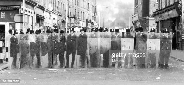 Policemen with riot shields form a cordon during the riots in Brixton April 11th 1981 The riots were sparked off by the stabbing of a black youth...