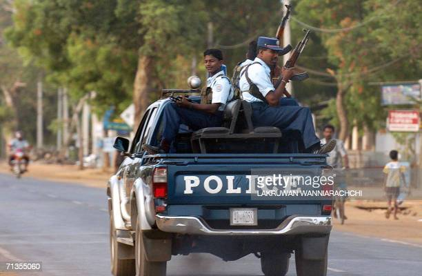 Policemen with the Tamil Tiger guerrillas patrol on a highway in the outskirts of the rebelheld town of Kilinochchi some 250 kilometers north of...