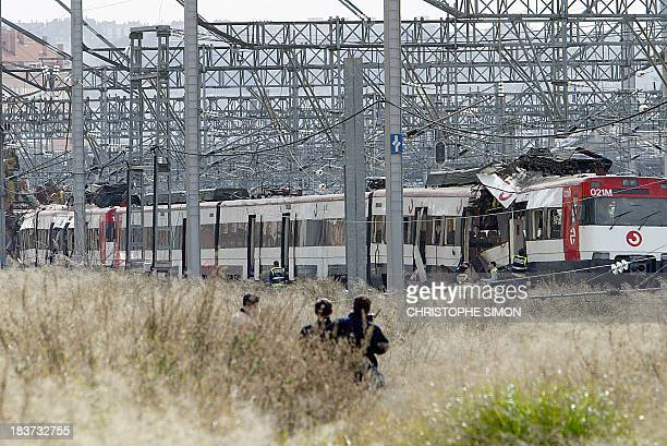 policemen work after a train exploded at the Atocha train station in Madrid 11 March 2004 At least 173 people were killed and some 600 injured early...