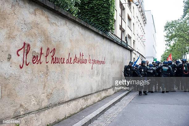 """Policers are behind a tag """"It is time to remove the government"""", in Paris, France on june 14, 2016. Unions organized the 9th day of..."""