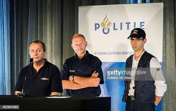 UK police's detective inspector Howard Way LTFO Dutch spokesman Arie de Bruijn and German chief detective Attila Hohn speak during a press conference...