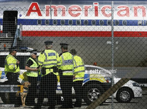 Polices officer with a sniffer dog prepare to board an American Airlines plane at Glasgow Airport on August 10 2006 in Glasgow Scotland British...