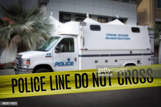 Policetape next to a mobile unit of CSI Escondido