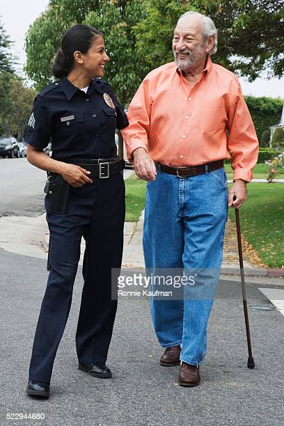 Policewoman Assisting Elderly Man