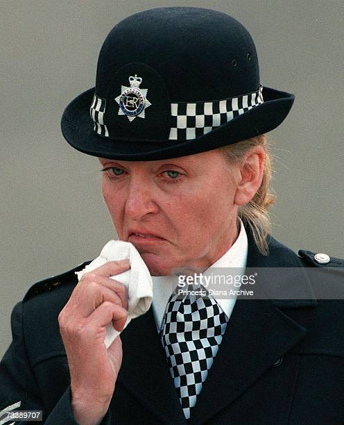 A policewoman crying outside Westminster Abbey during the funeral service of Princess Diana Princess of Wales 6th September 1997