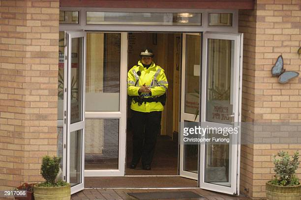 A policewoman guards an exit after a fire at Rose Park old peoples home on January 31 2004 in Uddingston near Glasgow Scotland The fire broke out in...